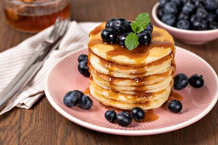 Pancakes with blueberries and syrup