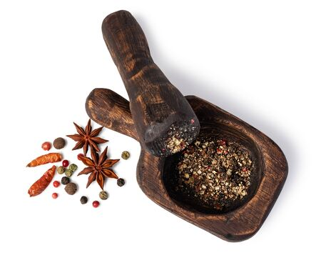 Mortar And Pestle With Pepper And Spices on a white Фото со стока