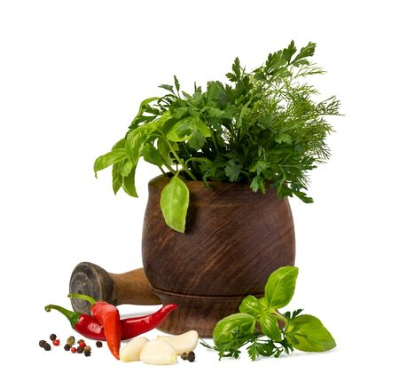 Fresh spices and herbs in mortar isolated on white background Фото со стока