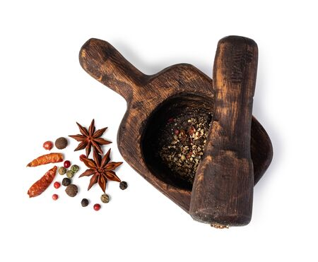 Mortar And Pestle With Pepper And Spices on a white Reklamní fotografie - 129996598