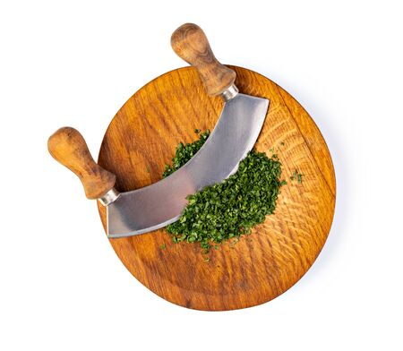 Parsley. On a chopping board in the kitchen