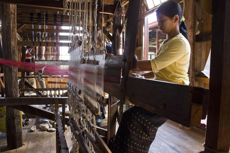 Myanmar hand-loom woman  The Padaung people are one of the many minority tribes in Myanmar  Padaung women are known for weaving on back-strap looms  They tie one side of the loom to a pole and the other side to their back