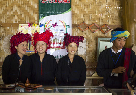 Typical girls from Shan State in Myanmar  The orangey, red headscarfs are worn by women of the Pa-O ethnic group  The Pa�O people are of Tibetan-Burmese descent