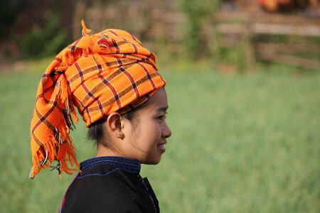 pao: Typical girl from Shan State in Myanmar  The orangey, red headscarfs are worn by women of the Pa-O ethnic group  The Pa�O people are of Tibetan-Burmese descent  Editorial