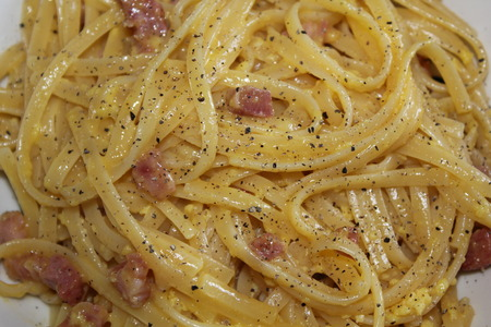 pastasciutta: Spaghetti alla Carbonara  is one of the most popular Italian pasta dishes  Carbonara recipe combines  eggs, cheese and bacon  At the end, black pepper at will