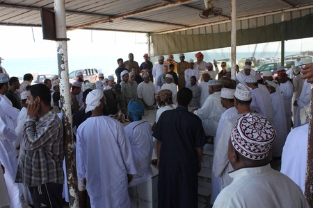 everyday people: Barka, Oman, October 20, 2013: Daily Fish market in Barka, Oman, were fresh seafood is sold everyday. People around the market. Editorial