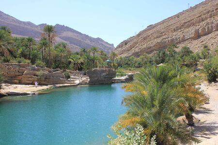 Wadi: Moqul Cave in Wadi Bani Khalid, an oasis in the Oman desert landscape  Stock Photo