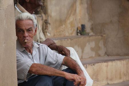 man smoking: Trinidad, Cuba, August 19, 2012. An old man smoking a typical cuban cigar.