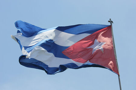 flad: The Cuba flag waving in the blue-sky