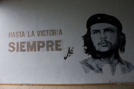 politic: Santa Clara, Cuba, politic propaganda. A wall script in favour of the revolution. The island of Cuba is full of billboards  walls posters showing images and slogans that promote the blessings of the Cuban Revolution. They really  Editorial