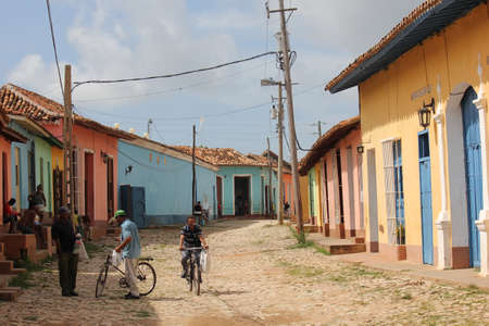 Daily life in Trinidad Cuba. People outside their colorful houses