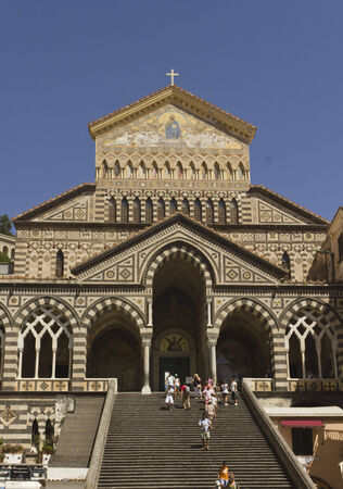 predominantly: Amalfi, Italy, August 11, 2014: Amalfi Cathedral (it.Duomo di Amalfi), a Roman Catholic structure, dedicated to the Apostle Saint Andrew. Predominantly of Arab-Norman Romanesque architectural style Editorial