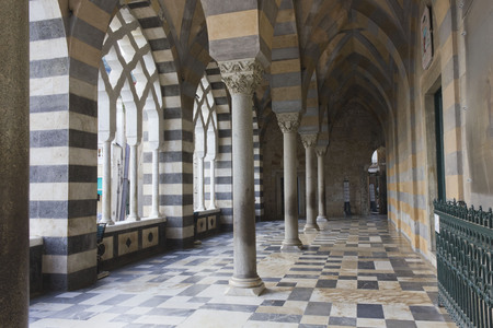 Amalfi, Italy, August 11, 2014: Amalfi Cathedral  (it.Duomo di Amalfi), external colonnade. The church is dedicated to the Apostle Saint Andrew. Predominantly of Arab-Norman Romanesque architectural style