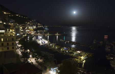 Amalfi, Italy, August 11, 2014: Amalfi Coast by night. The Amalfi Coast (Italian: Costiera Amalfitana) is a stretch of coastline on the southern coast of the Sorrentine Peninsula in the Province of Salerno in Southern Italy