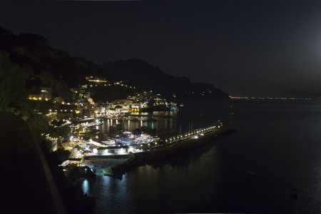 nightview: Amalfi, Italy, August 11, 2014: Amalfi Coast by night. The Amalfi Coast (Italian: Costiera Amalfitana) is a stretch of coastline on the southern coast of the Sorrentine Peninsula in the Province of Salerno in Southern Italy
