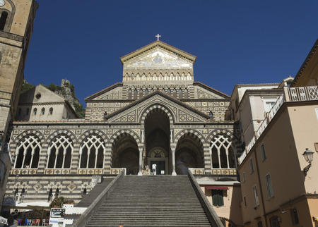 Amalfi, Italy, August 12, 2014: Amalfi Cathedral (it.Duomo di Amalfi), a Roman Catholic structure, dedicated to the Apostle Saint Andrew. Predominantly of Arab-Norman Romanesque architectural style