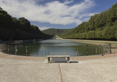 exemplar: Caserta, Italy, August 14, 2014: Caserta Royal Palace garden. The park is a typical exemplar of the Italian garden, landscaped with vast fields, flower beds and, above all, a triumph of ?water games? or dancing fountains