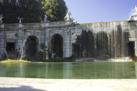 exemplar: Caserta, Italy: Caserta Royal Palace garden. The park is a typical exemplar of the Italian garden, landscaped with vast fields, flower beds and, above all, a triumph of water games or dancing fountains Editorial