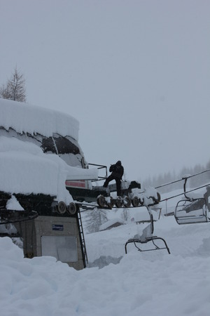 chair lift: Chair Lift in a snowy foggy day. Image taken in Madesimo, Italy