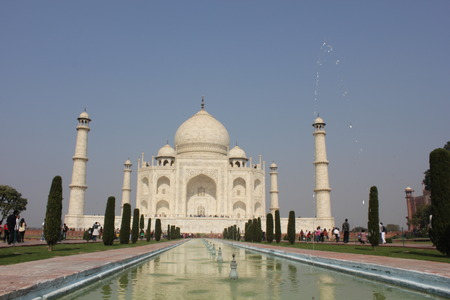 Agra, India: The Taj Mahal, a white marble mausoleum located in Agra, Uttar Pradesh, India. The Taj Mahal is widely recognized as the jewel of Muslim art in India and one of the universally admired masterpieces of the worlds heritage