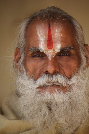 long beard: Jaipur, India: Indian man with long beard and the typical indian tilak symbol on the forehead, looking at the camera.
