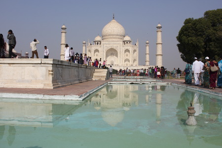 Agra, India: The Taj Mahal, a white marble mausoleum located in Agra, Uttar Pradesh, India. The Taj Mahal is widely recognized as the jewel of Muslim art in India and one of the universally admired masterpieces of the world