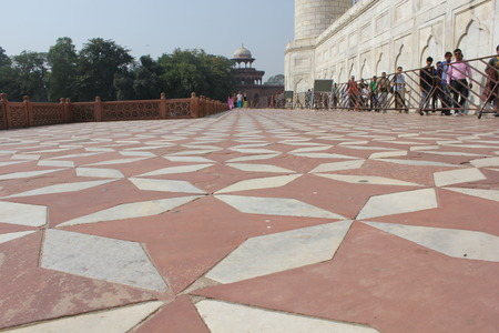 Agra, India: The Taj Mahal, a white marble mausoleum located in Agra, Uttar Pradesh, India. The Taj Mahal is widely recognized as the jewel of Muslim art in India and one of the universally admired masterpieces of the world. Detail of the roof