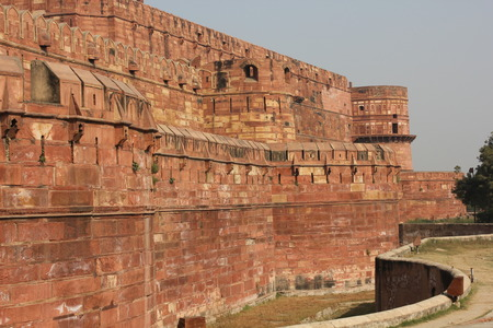 accurately: Agra Fort, India. The Agra Fort is an UNESCO World Heritage site located in Agra, Uttar Pradesh, India.The fort can be more accurately described as a walled city.