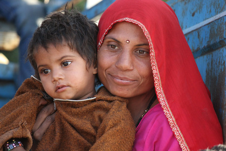 Pushkar, India: A beautiful Indian Mum with her son.