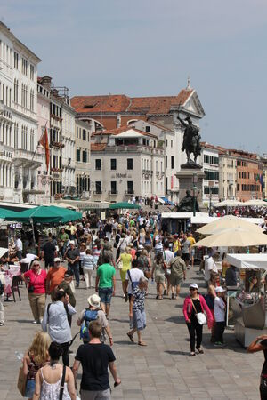 Venice: People walking on Riva degli Schiavoni, the first section of the Venice waterfront promenade