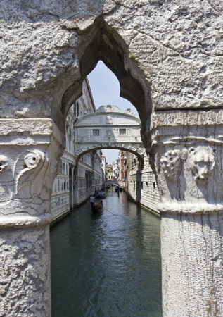 Venice, Italy, June 6 2014: The Bridge of Sighs. The enclosed bridge is made of white limestone and has windows with stone bars. It passes over the Rio di Palazzo and connects the New Prison to the interrogation rooms in the Doge Editorial