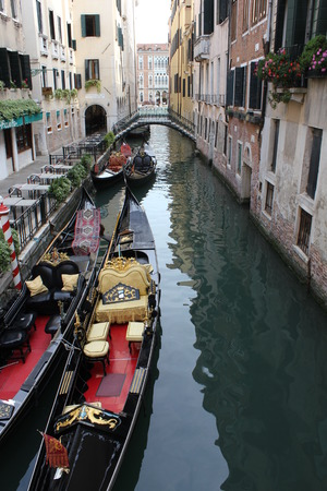 venice gondola: Venice, Italy,: Traditional Venice gondola parked in the water, on a typical Venetian narrow canal