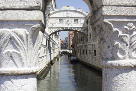 Venice, Italy: The Bridge of Sighs. The enclosed bridge is made of white limestone and has windows with stone bars. It passes over the Rio di Palazzo and connects the New Prison to the interrogation rooms in the Doge Editorial