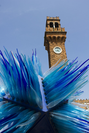 simone: Murano, Italy: San Pietro Martire Bell Tower and the famous blue glass sculpture from Italian artist Simone Cenedese Stock Photo