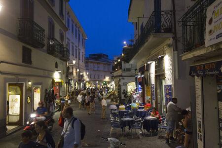 Amalfi, Italy: Amalfi main street at night. People walking on Amalfi street full of souvenirs shop and restaurants Editorial