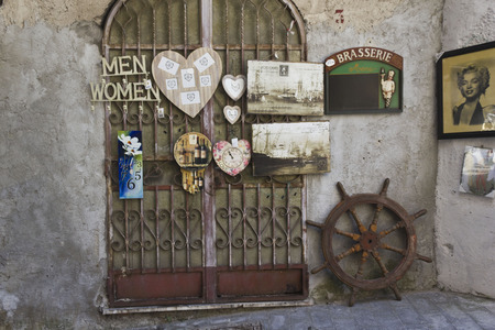 denominado retro: Amalfi, Italy: Vintage shop in Amalfi, with retro styled old papers label and a wheel