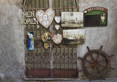 retro styled: Amalfi, Italy: Vintage shop in Amalfi, with retro styled old papers label and a wheel