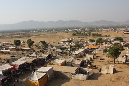 aereal: Pushkar, India: View from the top of the Ferris wheel of the city of Pushkar and its famous Camel Fair
