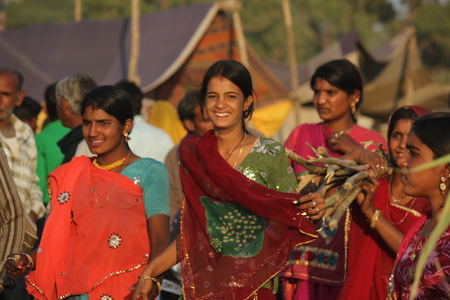 PUSHKAR, INDIA : Indian girls with traditional colored saree on the street of Pushkar during the Camel Fair exhibition