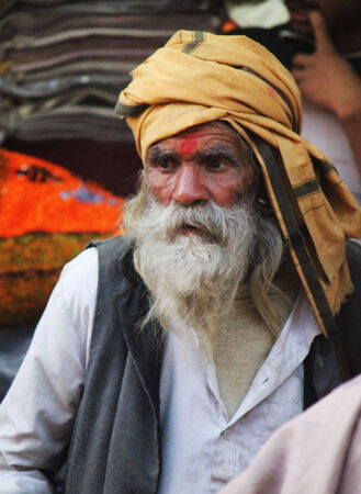white beard: PUSHKAR, INDIA: Indian Man with long white beard and orange turban and in the streets of pushkar in India