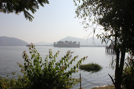 sagar: JAIPUR, INDIA - Jal Mahal (meaning Water Palace) in a foggy day. The Palace is a palace located in the middle of the Man Sagar Lake in Jaipur city Stock Photo
