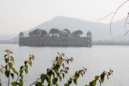 sagar: Jal Mahal, meaning Water Palace  in a foggy day. The Palace is a palace located in the middle of the Man Sagar Lake in Jaipur city, India