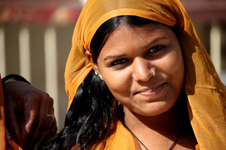 indian village: Jaipur, India: Beautiful Indian girl with traditional colorful saris, looking at the camera, in the Indian Rajasthan were Editorial