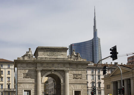 modernity: MILAN, ITALY - MAY 10: Milan Between history and Modernity. The Porta Nuova ancient arch and the new glass skyscraper behind it on May 10 2014 Editorial