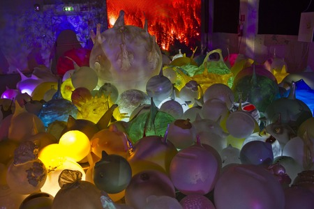 enlightening: MILAN, ITALY - APRIL 8; Design installation  GLOBOLAND populated by 'GLOBOLI': enlightened and enlightening characters born from the creativity of the artist topylabrys.