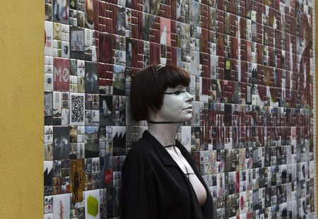 MILAN, ITALY - APR 8: Beautiful Wall Art in Milan in Via Tortona, with a girl standing on the wall, during the Fuorisalone on April 8 2014