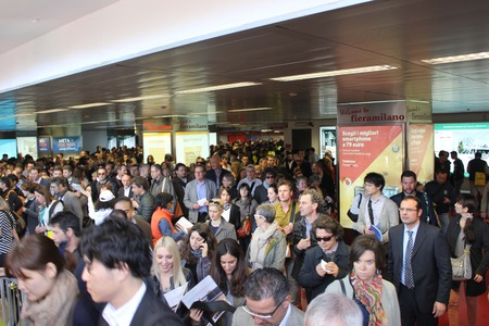 exhibition crowd: MILAN, ITALY - APR 9: Arriving at Rho Fiera (Milan Trade Fair). Crowd of people at the underground exit going to the Salone del Mobile fairon April 9 2014 Editorial