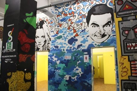 toilette: MILAN, ITALY - APR 8: Public toilette of the Spazio Ansaldo in Milan during the Fuorisalone in Milan on April 8 2014, with Kate Moss paint for the ladies and Mr.Bean for the men