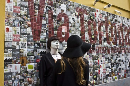 mimetic: MILAN, ITALY - APR 8: Beautiful Wall Art in Milan in Via Tortona, with a girl standing on the wall, during the Fuorisalone on April 8 2014