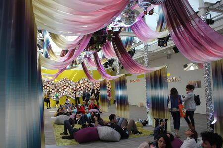 colore: MILAN, ITALY - APR 12: People relaxing in Missoni shop during the Milanese Fuorisalone 2014, with a beautiful and colore design intallation on April 12 2014